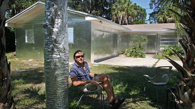 "<p>A US man has angered his neighbours by wrapping his Florida home and surrounding trees almost entirely in foil.</p><p> Piotr Janowski, a self-described artist from Tarpon Springs, started covering the rental property in the aluminium food wrapping using adhesive spray last May – similar to the process used with gold leaf. </p><p> ""The house was simply about the transformation, how easily you can transform an ugly, ordinary house to something else,"" he told the <a href="" http://www.tampabay.com/news/humaninterest/tarpon-springs-neighbors-baffled-by-house-trees-covered-in-aluminum-foil/2231578"">Tampa Bay Times</a>. </p><p> Click through to read more.</p>"