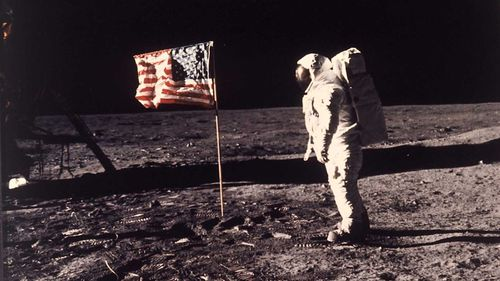 Buzz Aldrin stands beside the American flag on the moon, in a photo taken by Neil Armstrong.