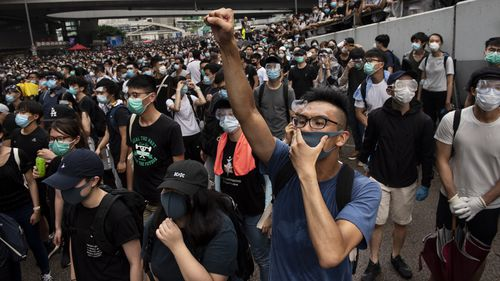A protester chants slogans against the Chief Executive of Hong Kong Carrie Lam during the demonstration. Thousands of protesters occupied the roads near the Legislative Council Complex in Hong Kong to demand to government to withdraw extradition bill.