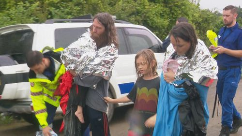 The couple and two children made it to short with paramedics at the ready.