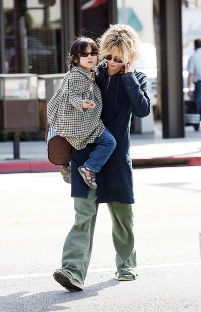America's sweetheart, actress Meg Ryan, picks up daughter Daisy from school in low key cargo pants and sneakers.