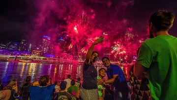 People watch fireworks ahead of New Year's Eve over the Brisbane River at Southbank in Brisbane last year.