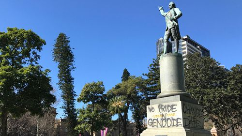 This statue of Captain James Cook was sprayed with slogans in 2017, in protest of Australia day.