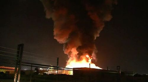 A metal recycling plant in Brisbane's east was turned into a flaming inferno due to a spark from a working machine. Picture: 9NEWS.