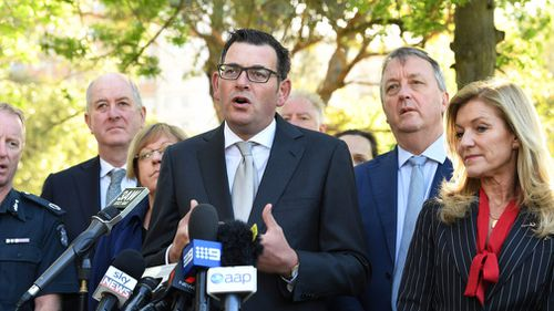 Victorian Premier Daniel Andrews, Police Minister Lisa Neville, Mental Health Minister Martin Foley and Planning Minister Richard Wynne hold a media conference announcing the trial. (AAP)