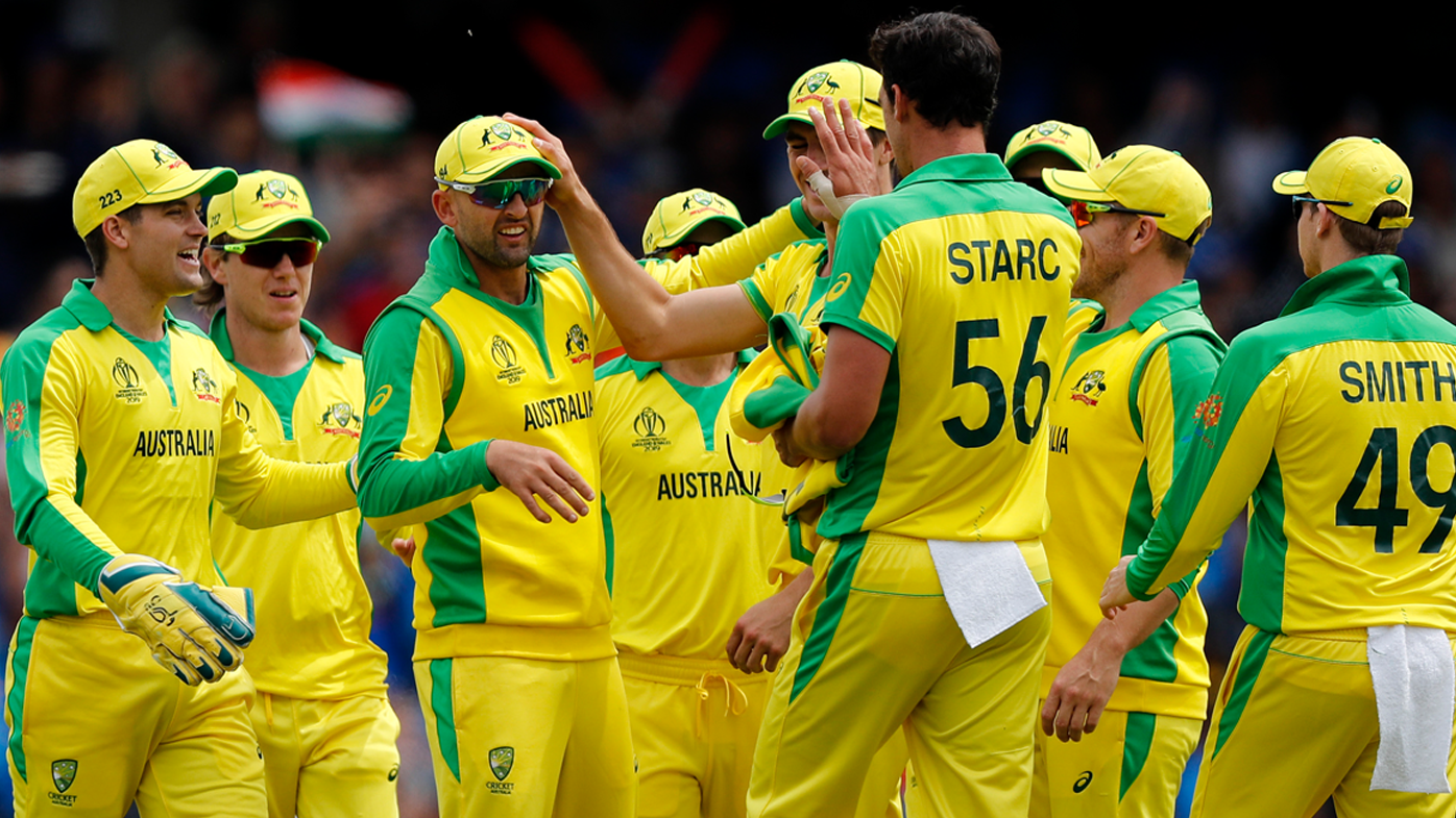 Nathan Lyon congratulates Mitchell Starc on a wicket