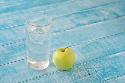 <strong>...a glass of water and an apple.</strong>