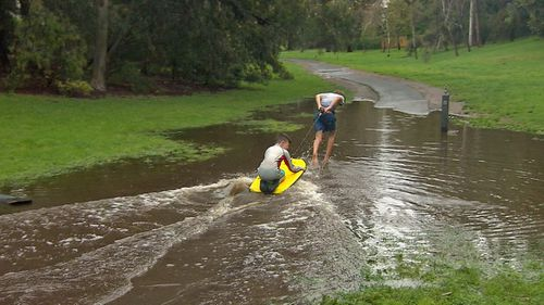 The rain didn't keep everyone indoors, turning parks into a playground for kids