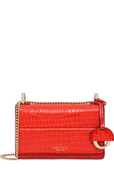 "<a href=""- https://www.oroton.com.au/w1/i7392249"" target=""_blank"" draggable=""false"">Oroton Forte Texture Super Mini Clutch, $295.00</a>"