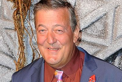 British comedian Stephen Fry, who plays the Master of Laketown in <i>The Hobbit</i>, smiles for fan snaps.