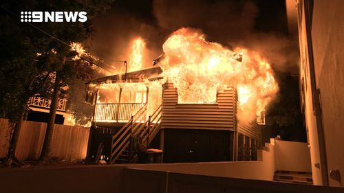 The timber home became fuly engulfed with flames. Picture: 9NEWS