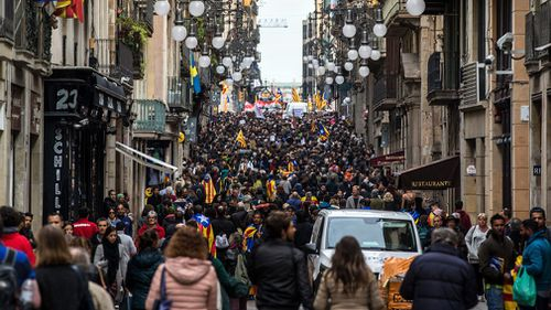 Students take part in a demonstration to protest against the imprisonment of pro-independence leaders and to demand their freedom at Las Ramblas in Barcelona. (AAP)