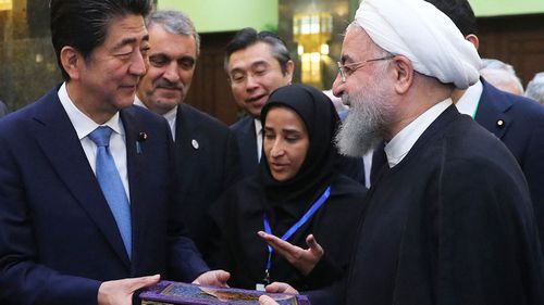 Iranian President Hassan Rouhani and Japanese Prime Minister Shinzo Abe visit an exhibition of 90th anniversary of Iran-Japan diplomatic relations in Tehran, Iran.