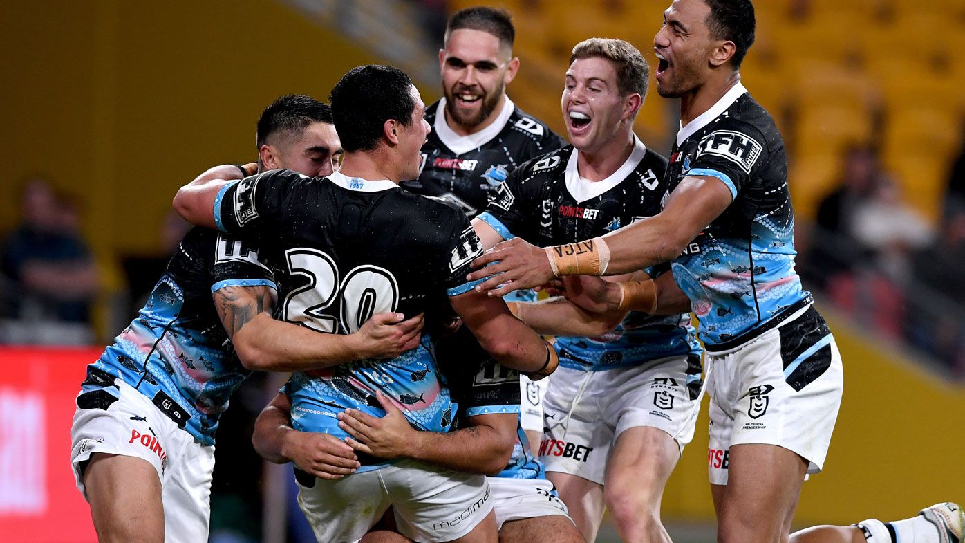 Sharks get the better of the Broncos. (Getty)