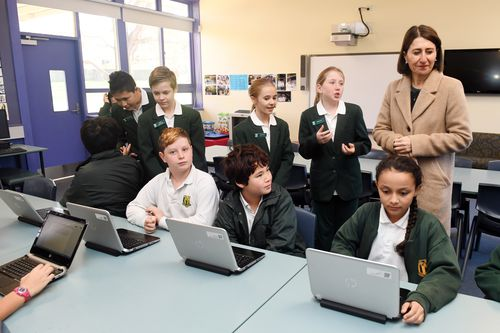 NSW Premier Gladys Berejiklian (right) talks to students during a visit to Kent Road Public School in Marsfield, Sydney. (AAP)