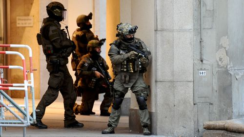 Police secures the area of a subway station Karlsplatz (Stachus) near a shopping mall following a shooting in Munich. (AFP)