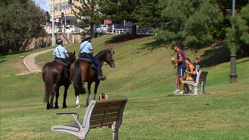 Mounted police move people on at Bondi.