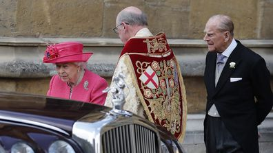 Queen Elizabeth II and Prince Philip leave the chapel after the wedding of Lady Gabriella Windsor.