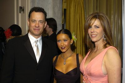 Singer Christina Aguilera with Tom Hanks and Rita Wilson during EIF's Cancer Research Fund at Regent Beverly Wilshire in Beverly Hills in 2004
