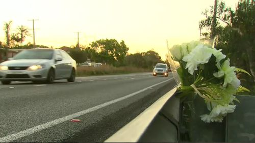 A floral tribute has been left to honour Adam Beattie. Picture: 9NEWS