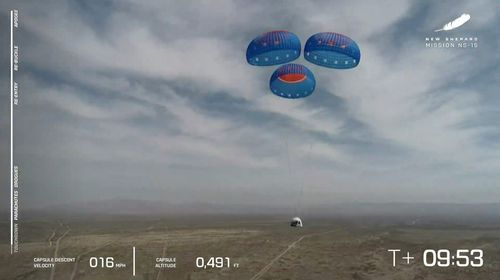 In this image from video made available by Blue Origin, the New Shepard capsule uses parachutes to land during a test in West Texas on Wednesday, April 14, 2021.