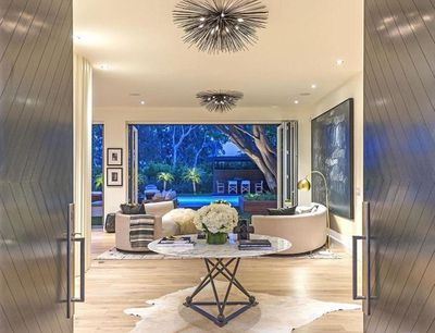 Entering the home, you'll be greeted by a marble table with views out to the backyard entertaining area.