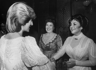 Princess Diana meets Elizabeth Taylor backstage at the Victoria Palace Theatre after a charity premiere of 'The Little Foxes', London, 1982