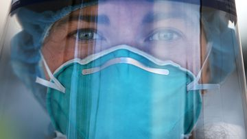 Registered Nurse Ali Murphy is seen wearing PPE (Personal Protective Equipment) at a Bondi Beach COVID-19 drive-through testing clinic, in Sydney, Australia.