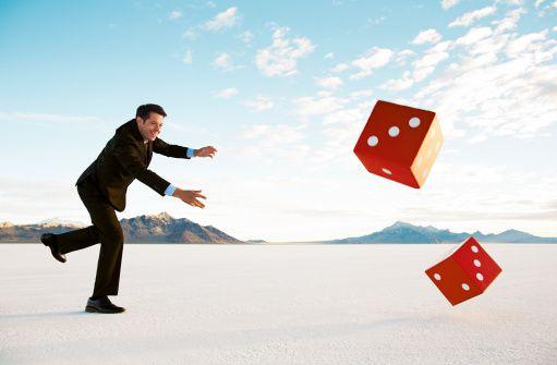 man rolling dice