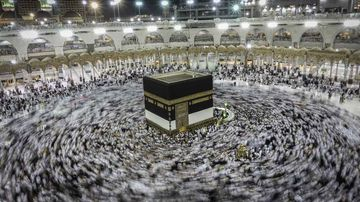 Muslim worshippers praying around the holy Kaaba at the Grand Mosque in Mecca. (AAP)