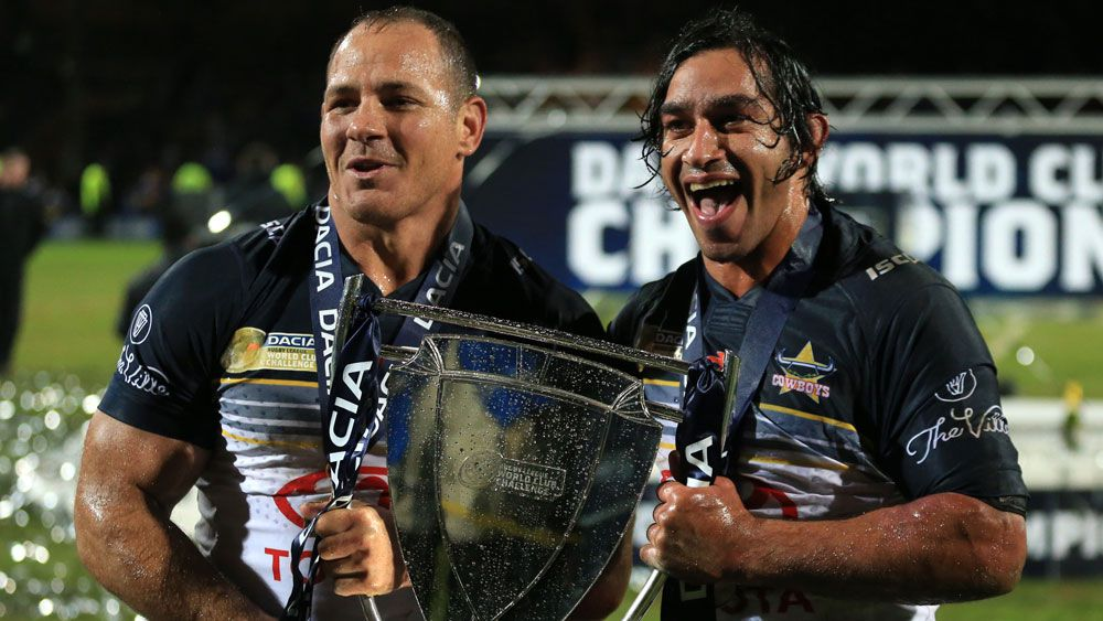 North Queensland's Matt Scott and Johnathan Thurston after they won the 2016 World Club Challenge. (AAP)