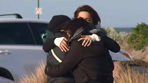 Family gathered at Altona were devastated to learn all three men died after their boat capsized. (9NEWS)