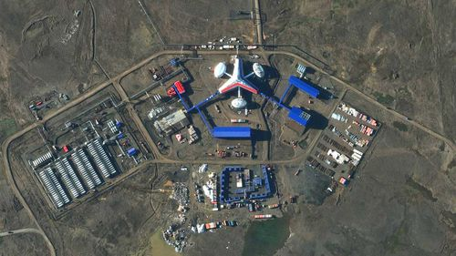 """Russia's northernmost military facility, the airfield in Nagurskoye is one of several """"trefoil"""" bases, featuring a three-ponged building painted in the colors of the Russian flag. Nagurskoye is seen here in 2016."""