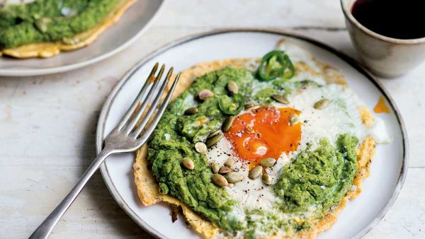 Chickpea flatbreads topped with spinach and egg