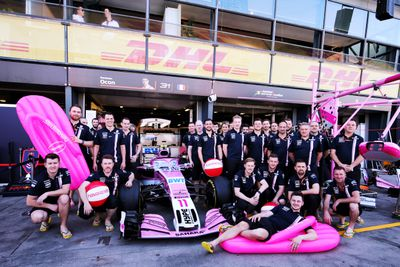 The Sahara Force India team getting into the Australian spirit with some pink inflatable thongs in their pit garage. (AAP)