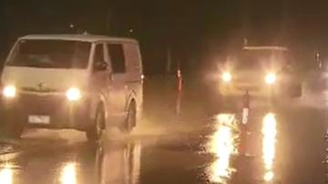 Flash flooding after cool change brings battering of rain