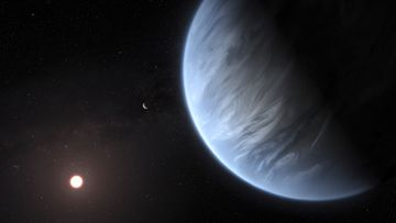 Exoplanet K2-18b, foreground, its host star and an accompanying planet in this system. On Wednesday, the scientists announced they discovered water on the planet outside our solar system that has temperatures suitable for life. (M. Kornmesser/ESA/Hubble via AP)