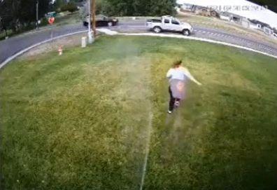 Woman running sprinkler
