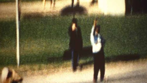 The 'umbrella man', identified as Louie Steven Witt, is a name given to a figure who appears in the Zapruder film, near the Stemmons Freeway sign within Dealey Plaza during the assassination of John F. Kennedy.