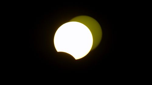 The solar eclipse is seen from Jiddah, Saudi Arabia.