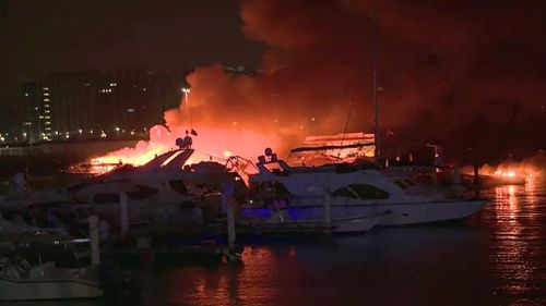 Fire fighters were able to save more then 200 boats moored at the marina. (Supplied/ AP)