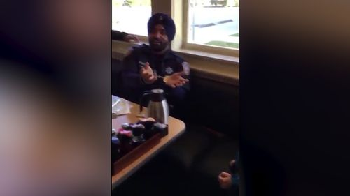 In a touching video Deputy Dhaliwal can be seen playing with a young boy who is deaf.