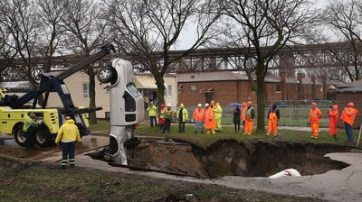 Two cars were swallowed by a sinkhole in Chicago in the US state of Illinois. (Getty)