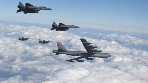 A US B-52 and its fighter escort during a training exercise in South Korea. (AAP)