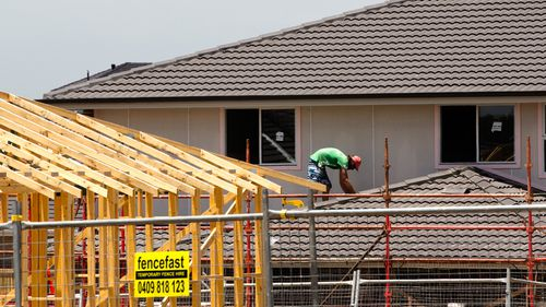 A tradesman works on a building site in Sydney.
