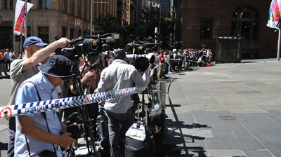 NSW Public Order and Riot Squad Police are seen outside the Lindt cafe in the central business district of Sydney. (AAP)