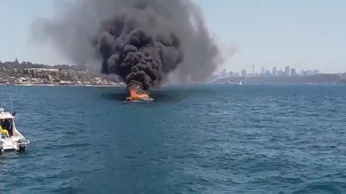 A luxury cruiser has erupted in flames off Watson's Bay near the entrance to Sydney Harbour.