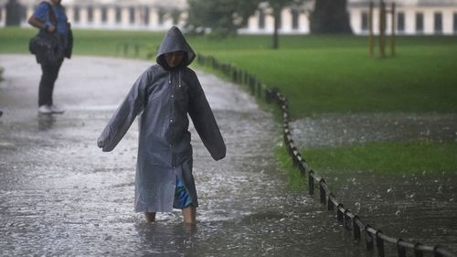 A woman walks through a flooded path in St James's Park in central London.