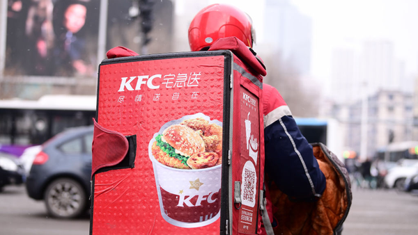A delivery staff of the KFC rides an electric bicycle along a road on January 8, 2020 in Shenyang, Liaoning Province of China.