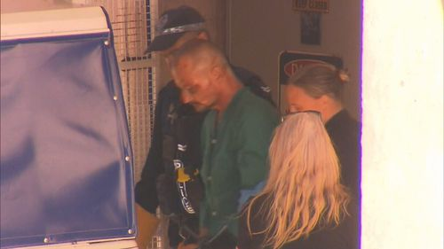 Accused mass murderer Ben Hoffman leaves hospital after surgery for knife wounds.